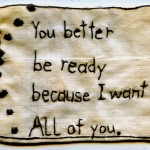 """All of You."" You better be ready because I want ALL of you. 2012. Embroidery on the last scraps of an antique table runner. 2"" x 2.5""."