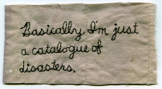 Embroidery on fabric dyed with onion skin. Borrowed text. 2″ x 3.75″. 2f7b15f0c85b